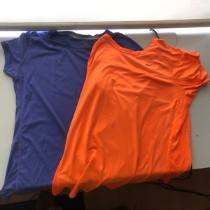 Two Nike short sleeved tops